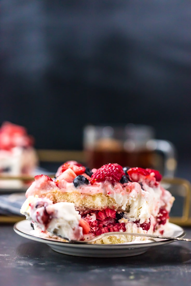 a slice of triple berry tiramisu on a small plate