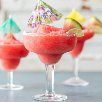 A Frozen Watermelon Margarita is just what you need for Cinco de Mayo! The best easy margarita all thrown together in a blender and ready to serve. SO REFRESHING!