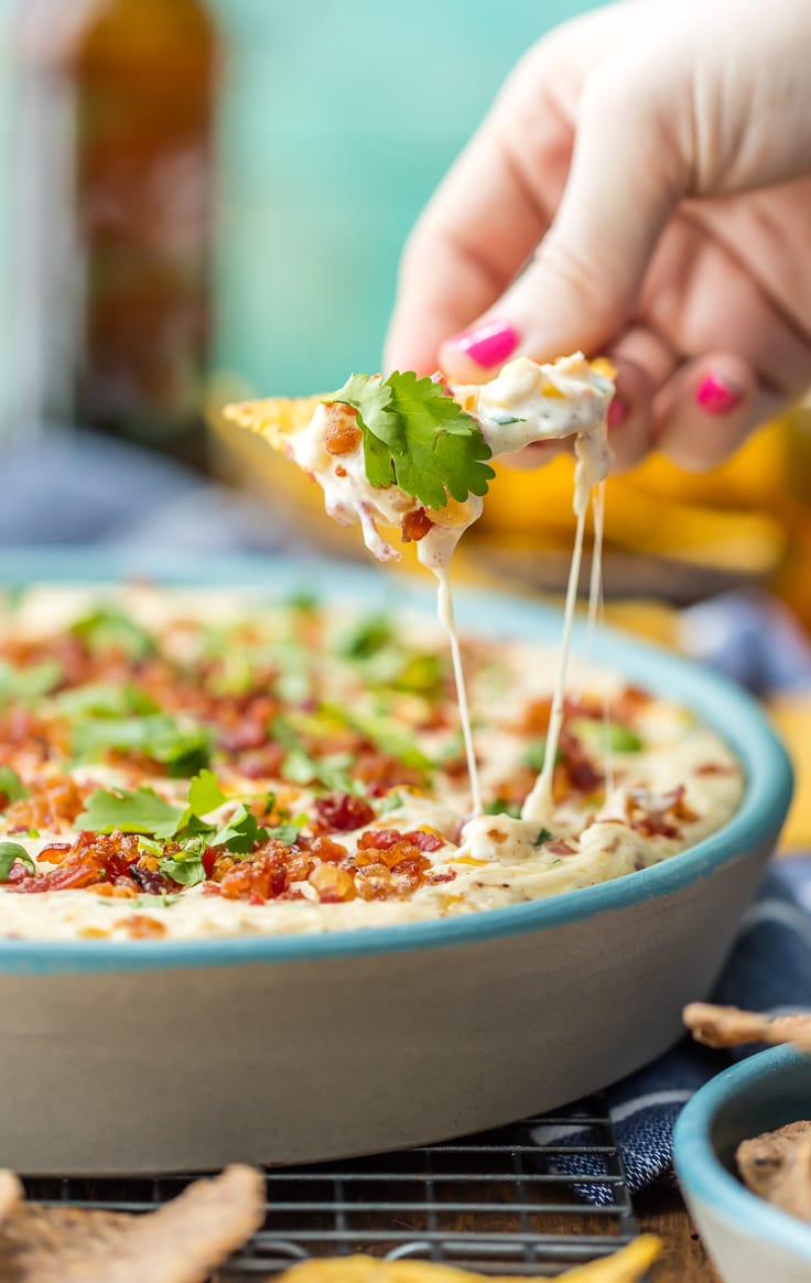 HOT CORN AND BACON BEER CHEESE DIP! The perfect appetizer for entertaining! Perfect for any party of tailgating! Our favorite Super Bowl Dip Recipe. Bacon Beer Cheese Dip is AMAZING!