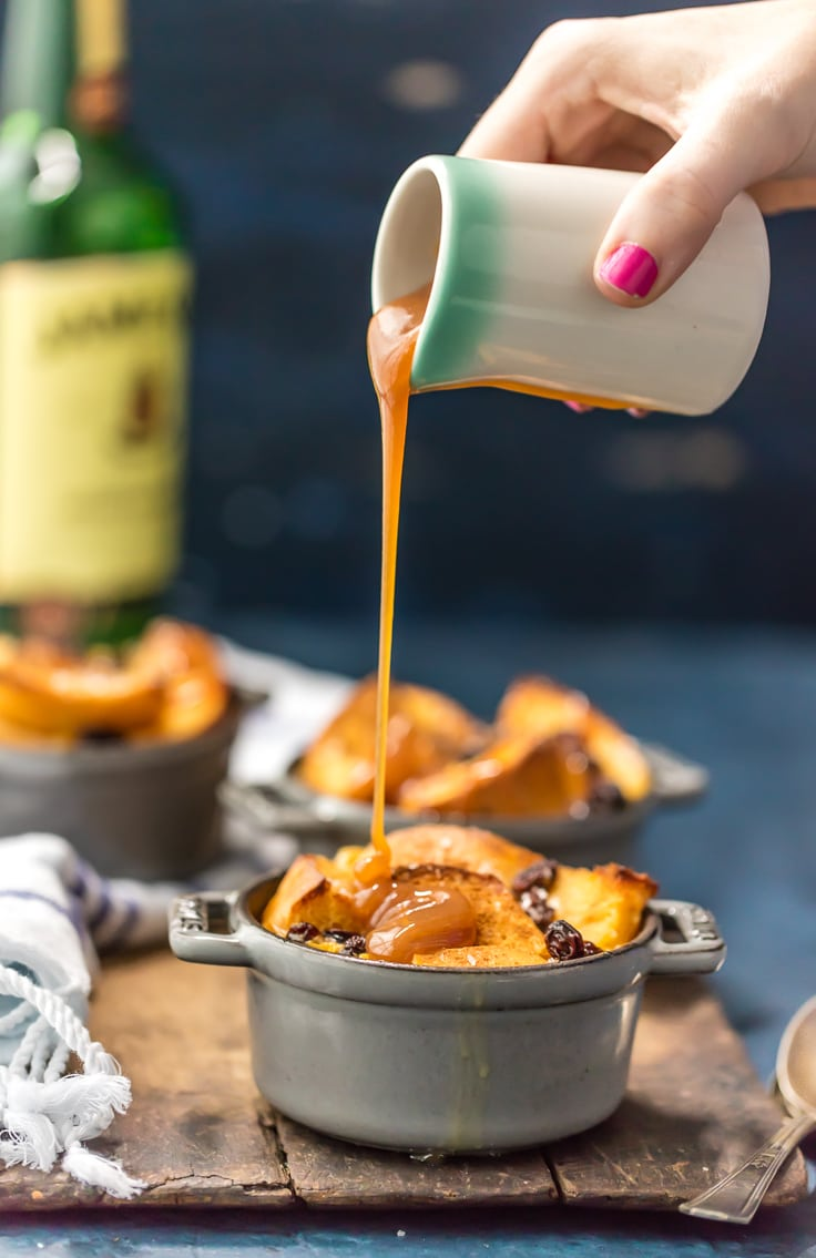 pouring caramel whiskey sauce over bread pudding