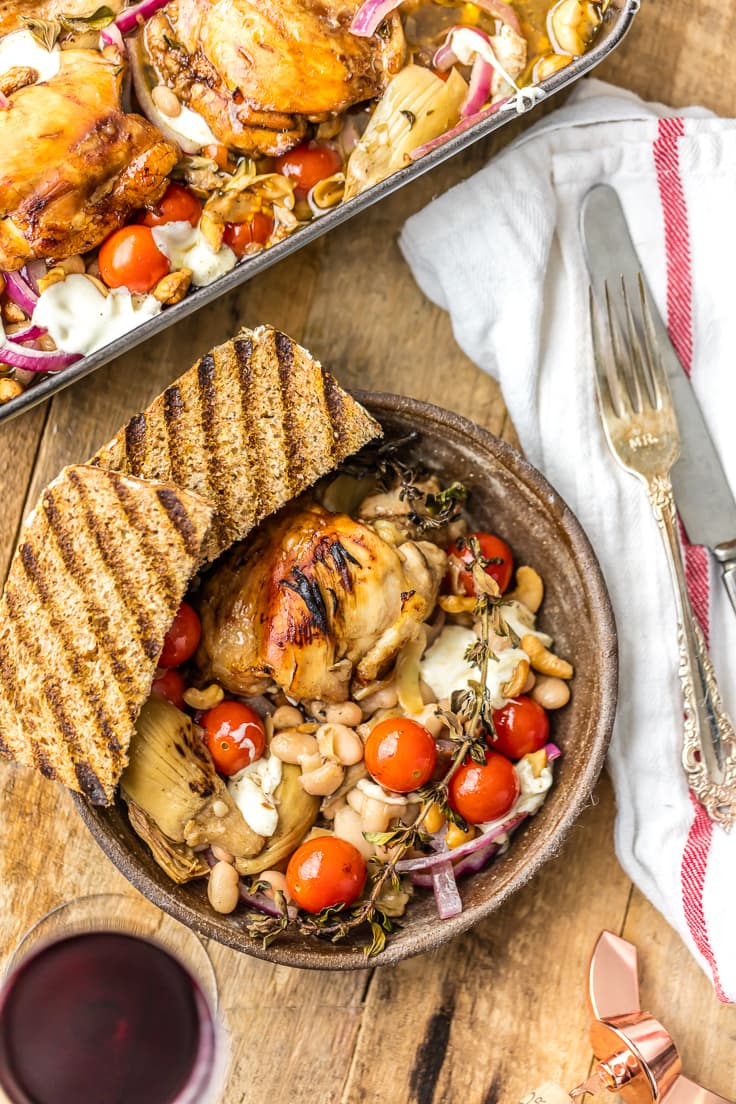 dinner plate of baked Mediterranean chicken with cherry tomatoes