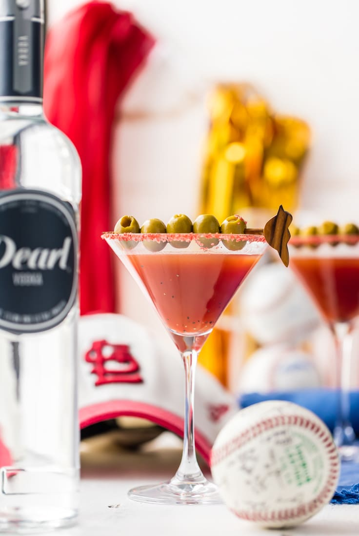 red martini with olives
