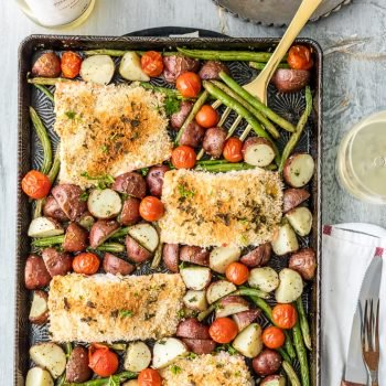 Honey Mustard Salmon and Potatoes is the perfect one pan dinner recipe! This healthy crusted salmon recipe with potatoes, green beans, and tomatoes makes an easy sheet pan dinner for any night of the week. It's made in under 30 minutes, healthy, and full of flavor!