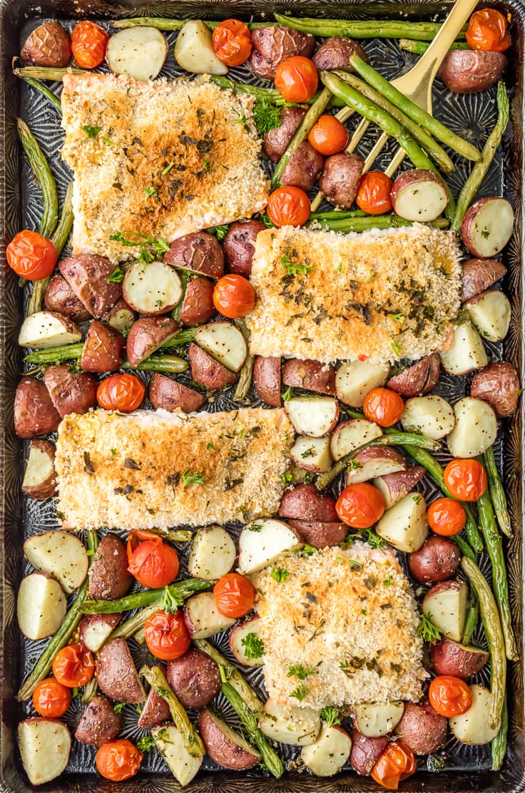 sheet pan filled with honey mustard salmon and potatoes, green beans, and tomatoes