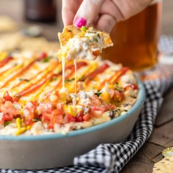 Cheeseburger Dip is the best dip recipe to celebrate Memorial Day and the Fourth of July! This bacon cheeseburger dip is loaded with bacon, Swiss, cheddar, hamburger, and everything else that makes cheeseburgers one of America's favorite foods!