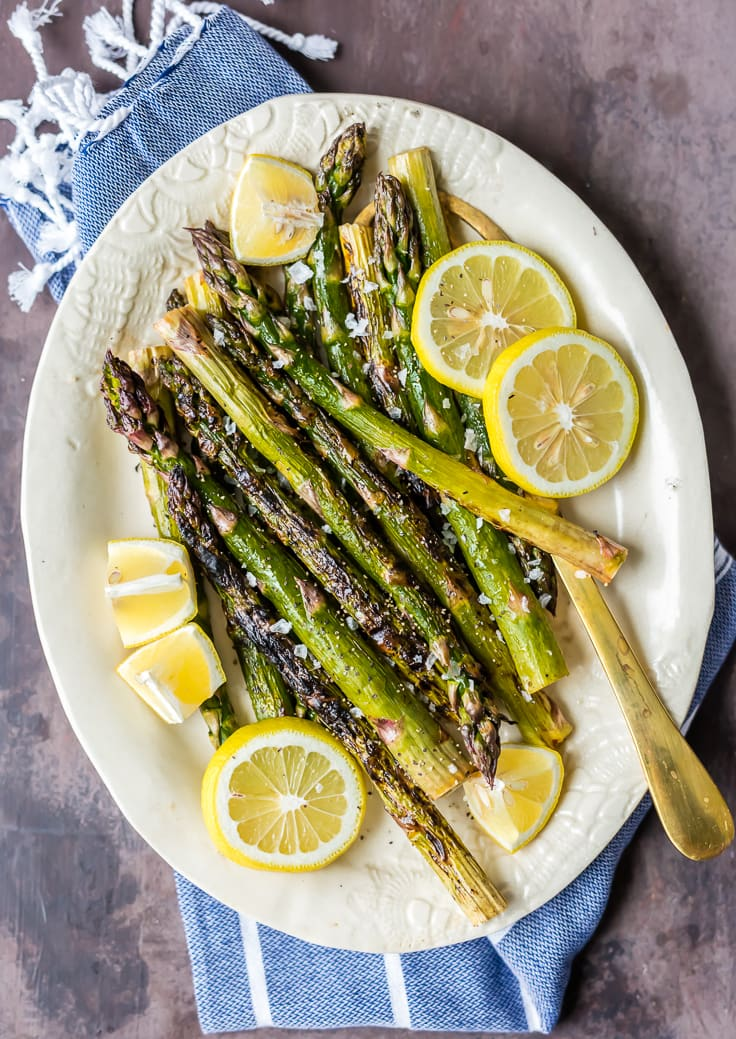 a plate of asparagus with lemon