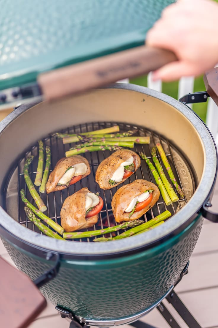 stuffed chicken and asparagus on a grill