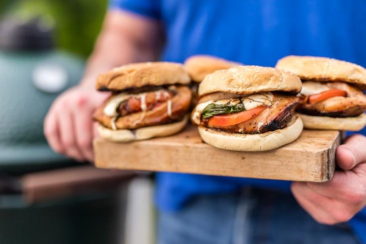 chicken caprese sandwiches on a cutting board