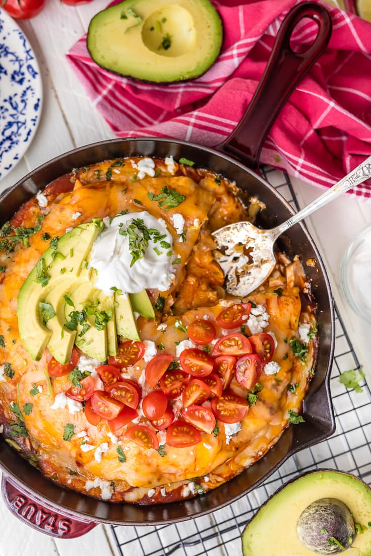 cheesy chicken enchiladas in a skillet