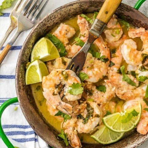 cilantro lime shrimp scampi in a bowl with fork