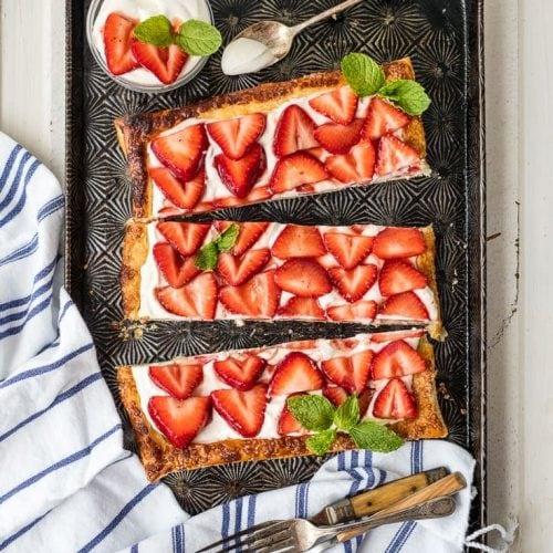 sliced strawberry tart on plate