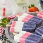 Red, White, and Blue Smoothie Pops on a table
