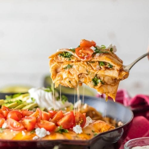 chicken enchilada skillet pie being lifted with a fork