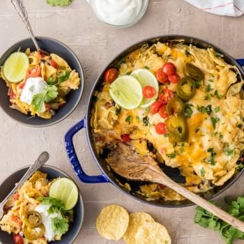 SUPER EASY CHICKEN NACHO CASSEROLE is our favorite Mexican weeknight meal! Throw it together, bake, and enjoy this cheesy, spicy, delicious, EASY Tex Mex meal in just minutes! Layered with chips, cheese, chicken, rotel, and more!