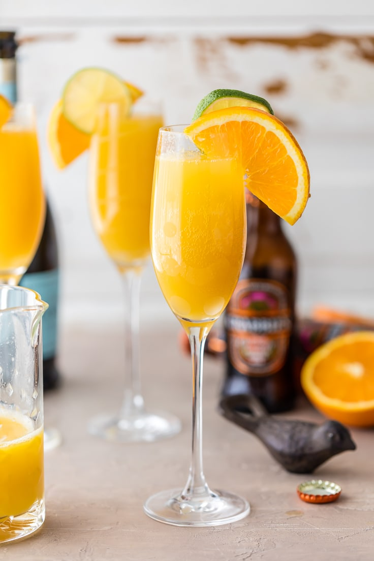 Moscow Mule Mimosas make for the BEST BRUNCH EVER! So easy, unique, delicious, and fun! Spiked ginger beer, orange juice, and champagne! YUM!