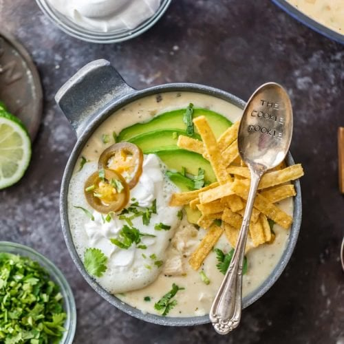 CREAMY WHITE CHICKEN CHILI made with CREAM CHEESE is the ultimate comfort food! Made in minutes and feeds up to 16 people! Freeze some for a delicious meal later. THE BEST WHITE CHICKEN CHILI EVER!