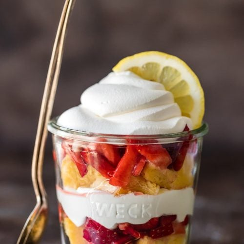 layered lemon strawberry shortcake cup with a spoon