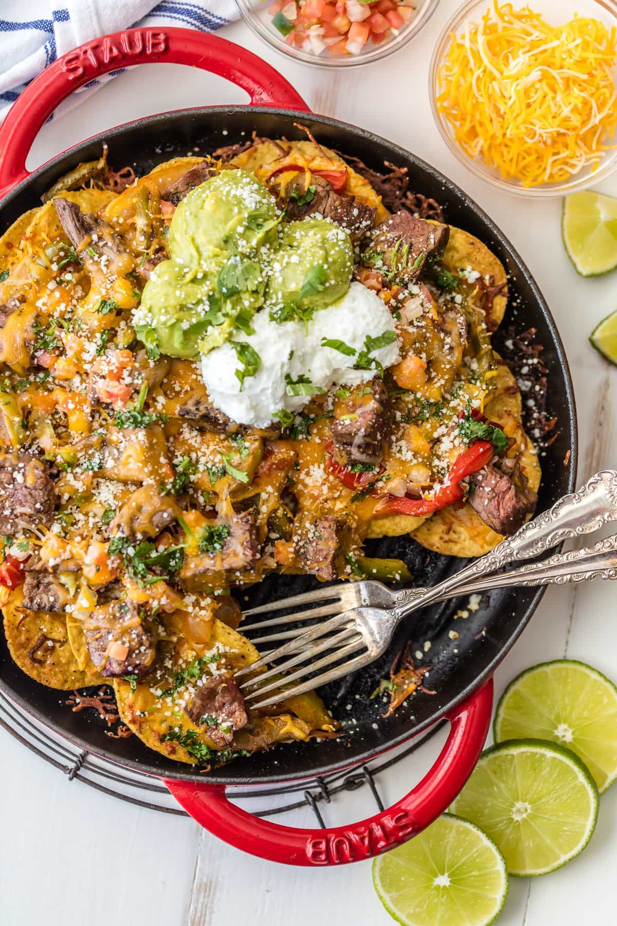 Steak Fajita Nachos in a skillet with two forks