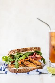 FRIED TOMATO BLTs with CILANTRO LIME MAYO is the best sandwich ever! Reimagine this classic recipe and make it a family favorite! Loaded with herbed fried tomatoes, cilantro lime mayo, arugula, and BACON!