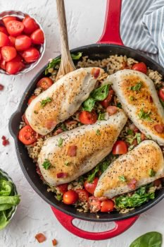 This BLT Chicken and Rice Skillet is the perfect one pan meal to feed the whole family! It's loaded with garlic, chicken, bacon, tomatoes, spinach, and a brown rice & quinoa mix! This chicken and rice recipe is totally delicious and SO EASY!