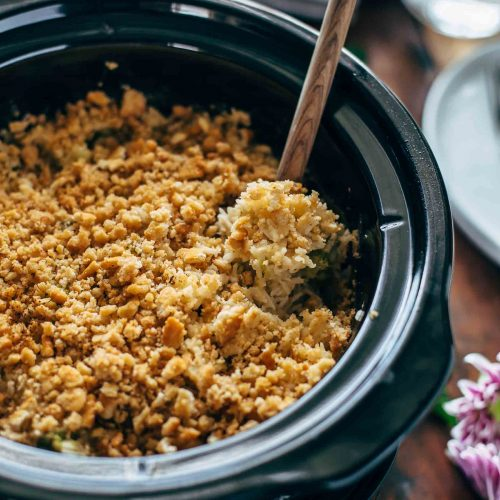 This Slow Cooker Velveeta Broccoli Rice Casserole is our go-to holiday side dish. Using a Crockpot is such an easy way to make cheesy broccoli and rice casserole. This Thanksgiving and Christmas favorite is easier than ever when made in a slow cooker!