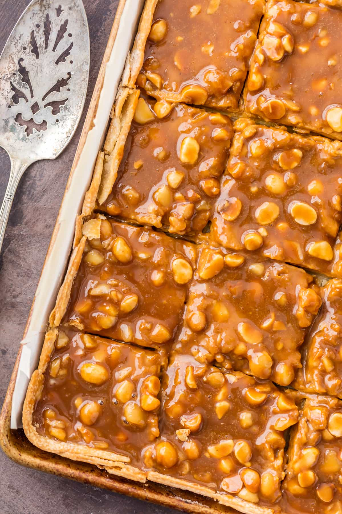 Caramel Macadamia Nut Pumpkin Pie Bars recipe in a baking sheet
