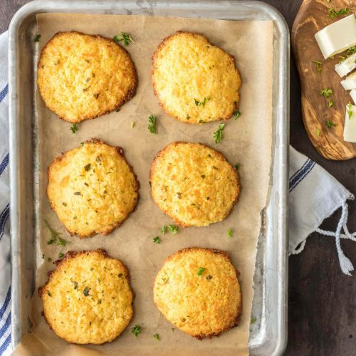 cheesy garlic cornbread drop biscuits on a cooking pan