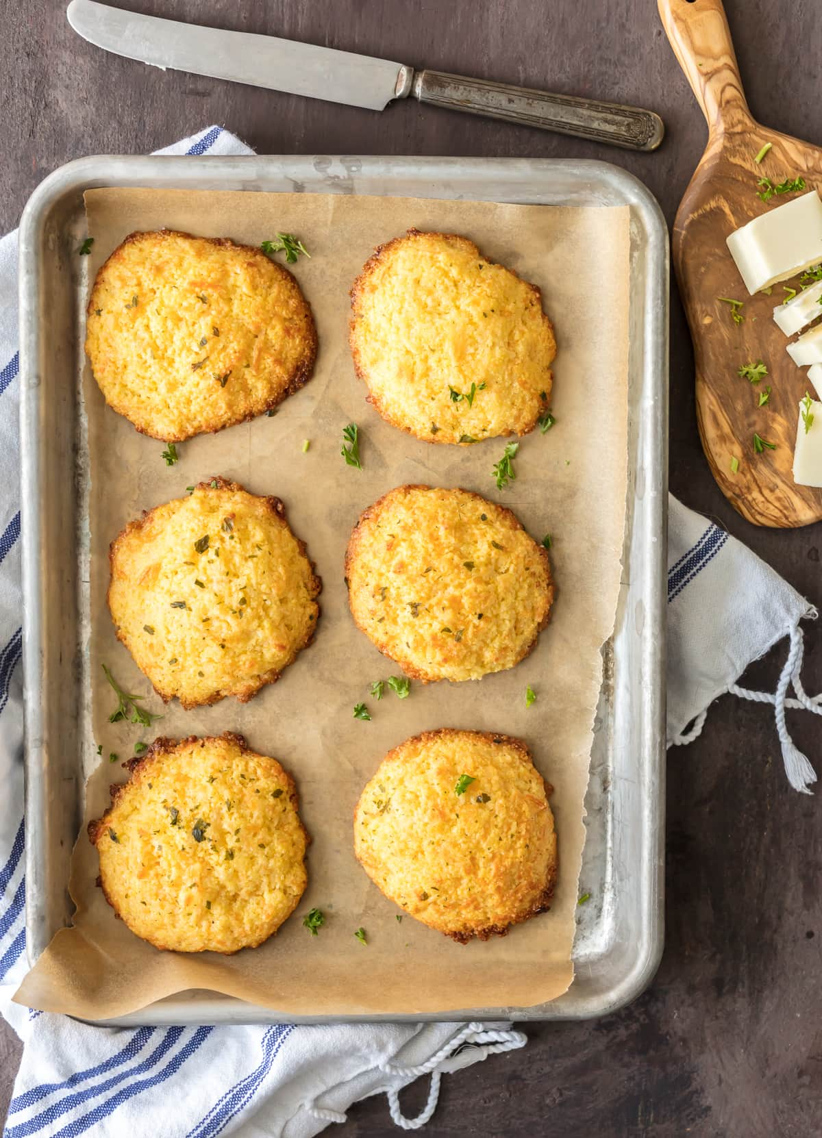 Cornbread drop biscuits on a baking sheet lined with parchment paper