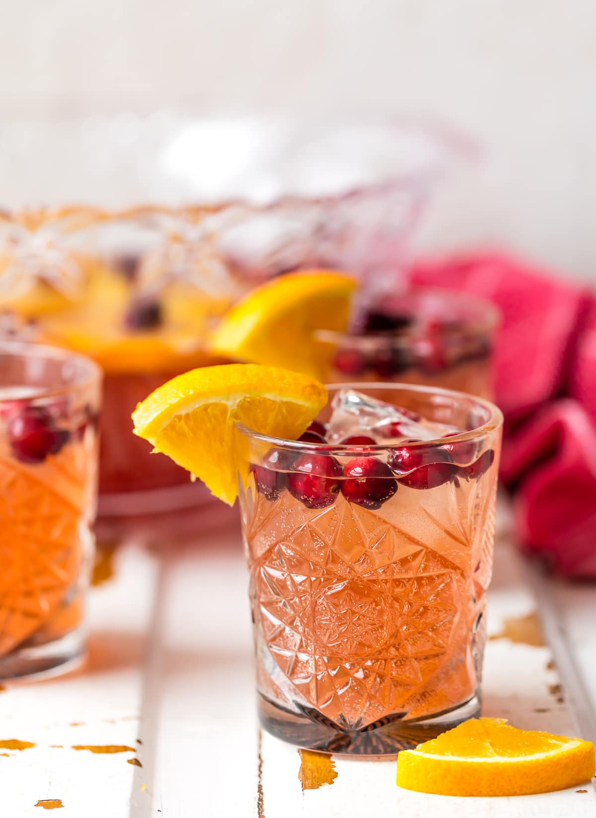 EASY HOLIDAY PUNCH perfect for Thanksgiving and Christmas! Cranberry Juice, Orange Juice, Ginger Ale, and more! Alcoholic or nonalcoholic versions!! Perfect party punch cocktail for a crowd!