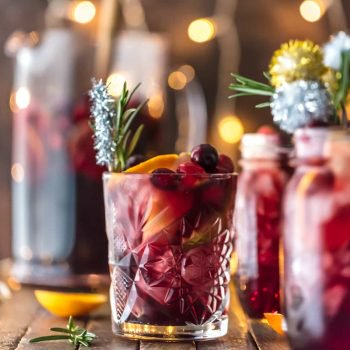 HOLIDAY SANGRIA is the perfect Christmas cocktail! It's made with red wine, vodka, sparkling apple cider, and several juices. Better yet, this Christmas Sangria is gluten free. You'll be the star of any holiday party with this recipe. Cheers!