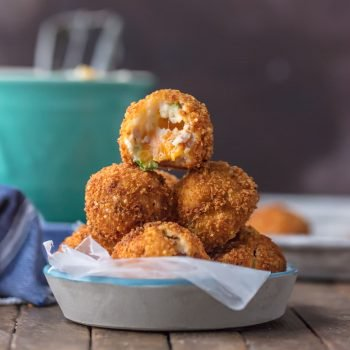 FRIED MASHED POTATO BALLS loaded with bacon, cheese, and onions are perfect for Thanksgiving leftovers! Put those leftover potatoes to good use and fry up some cheesy mashed potato bites. These loaded mashed potato balls make the ultimate appetizer or side dish!
