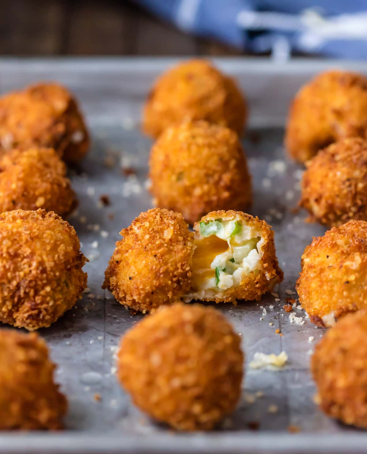 Deep Fried Mashed Potato Bites lined up on a baking sheet