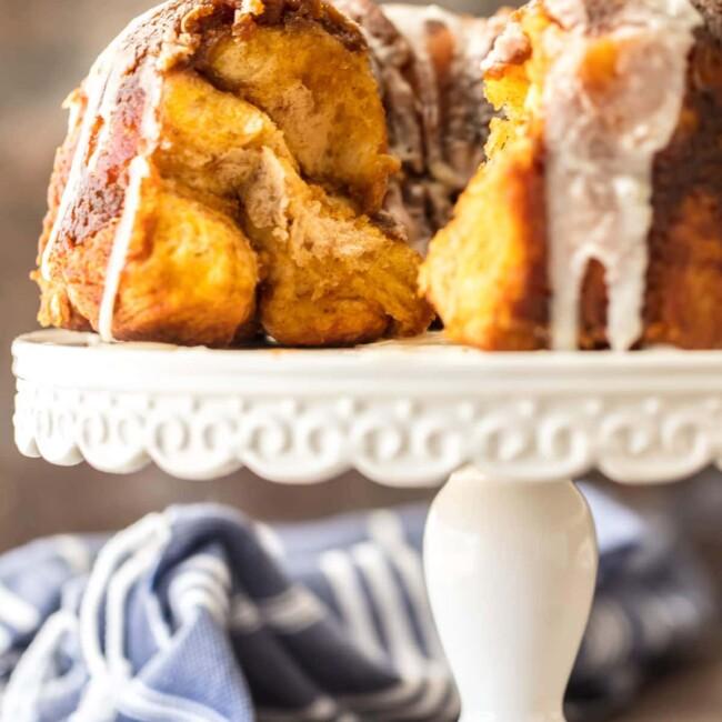 pumpkin pie monkey bread on a white cake stand