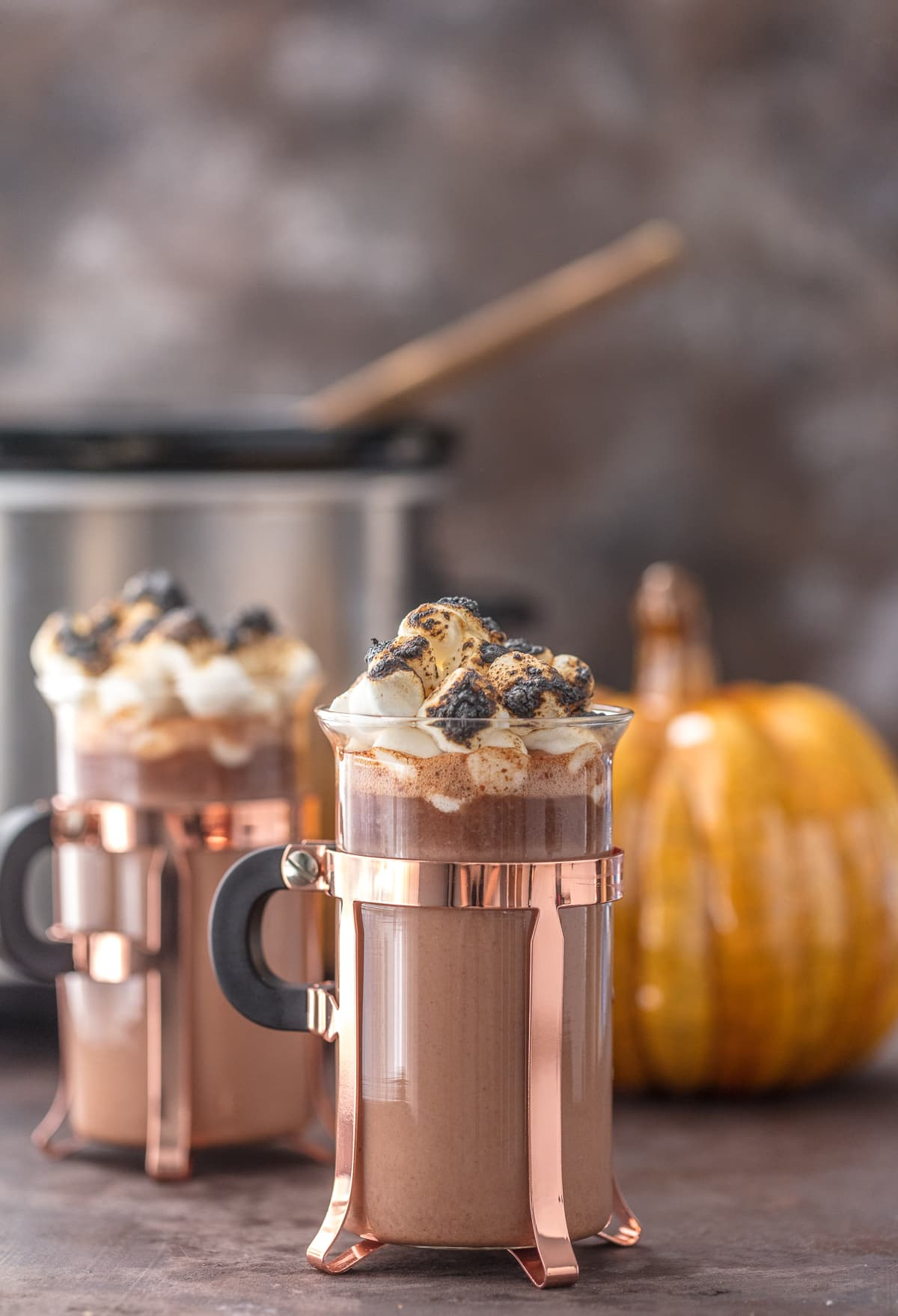 Spiked Pumpkin Spice Hot Chocolate in glass mugs, topped with toasted marshmallows