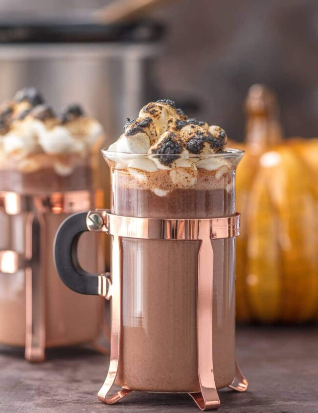 SPIKED PUMPKIN SPICE HOT CHOCOLATE is the ultimate Thanksgiving cocktail! This tasty spiked hot chocolate is made in a slow cooker and it's perfect for serving a crowd. This creamy twist on a classic is a must make for the holidays. Nothing is easier than slow cooker hot chocolate!