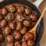 meatballs in a skillet with wooden spoon