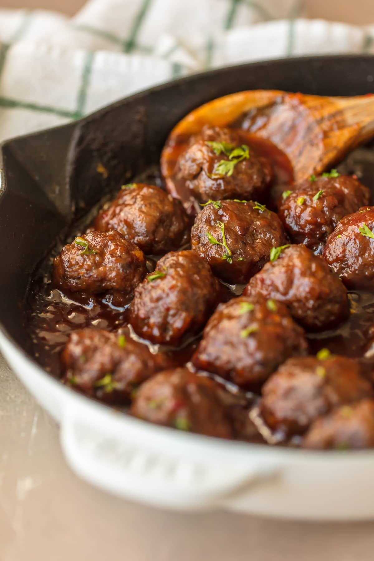 Sweet ans spicy cranberry meatballs in a skillet
