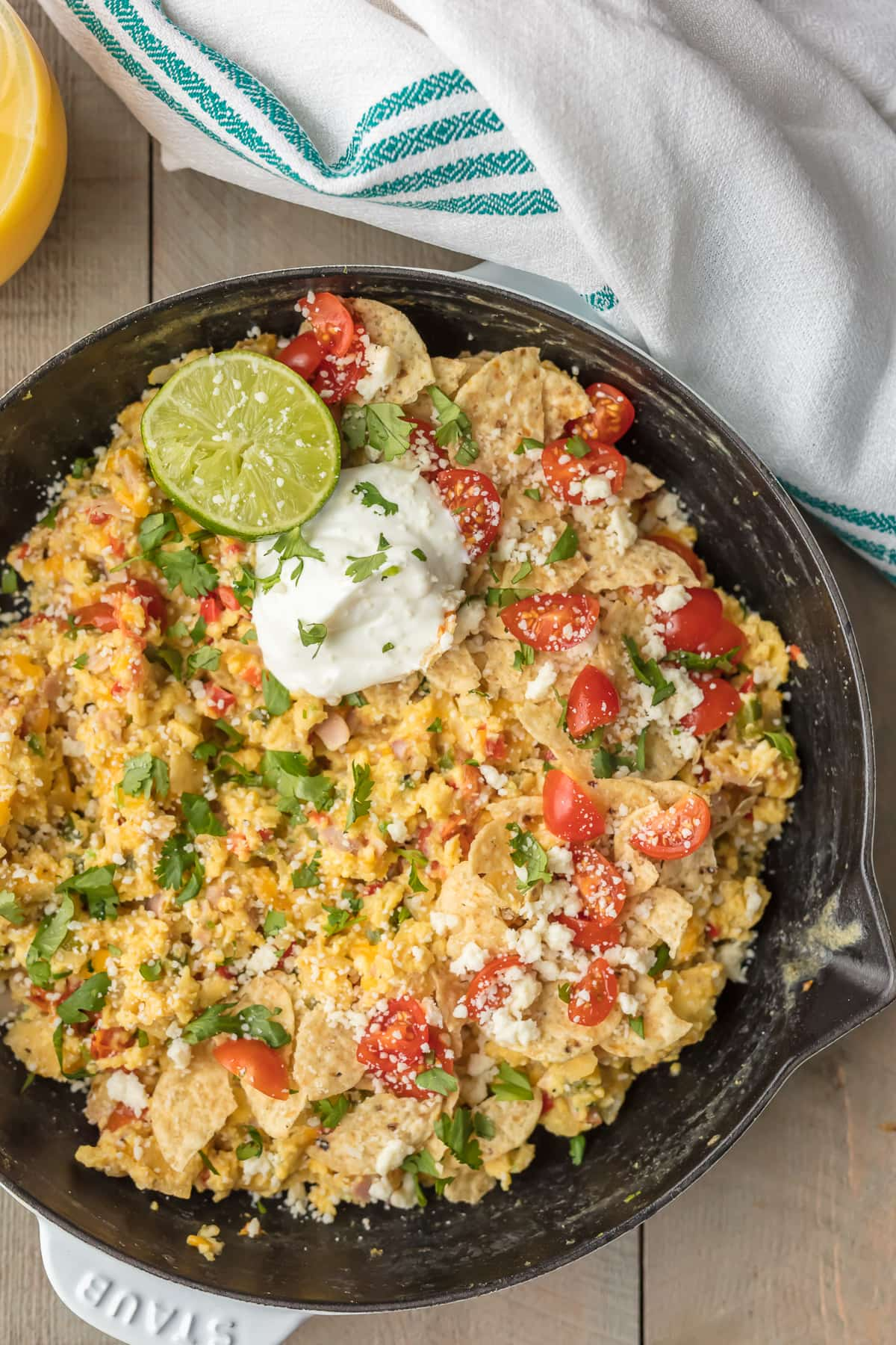 Cheesy Migas: eggs, tortilla chips, tomatoes, cheese, peppers, and more