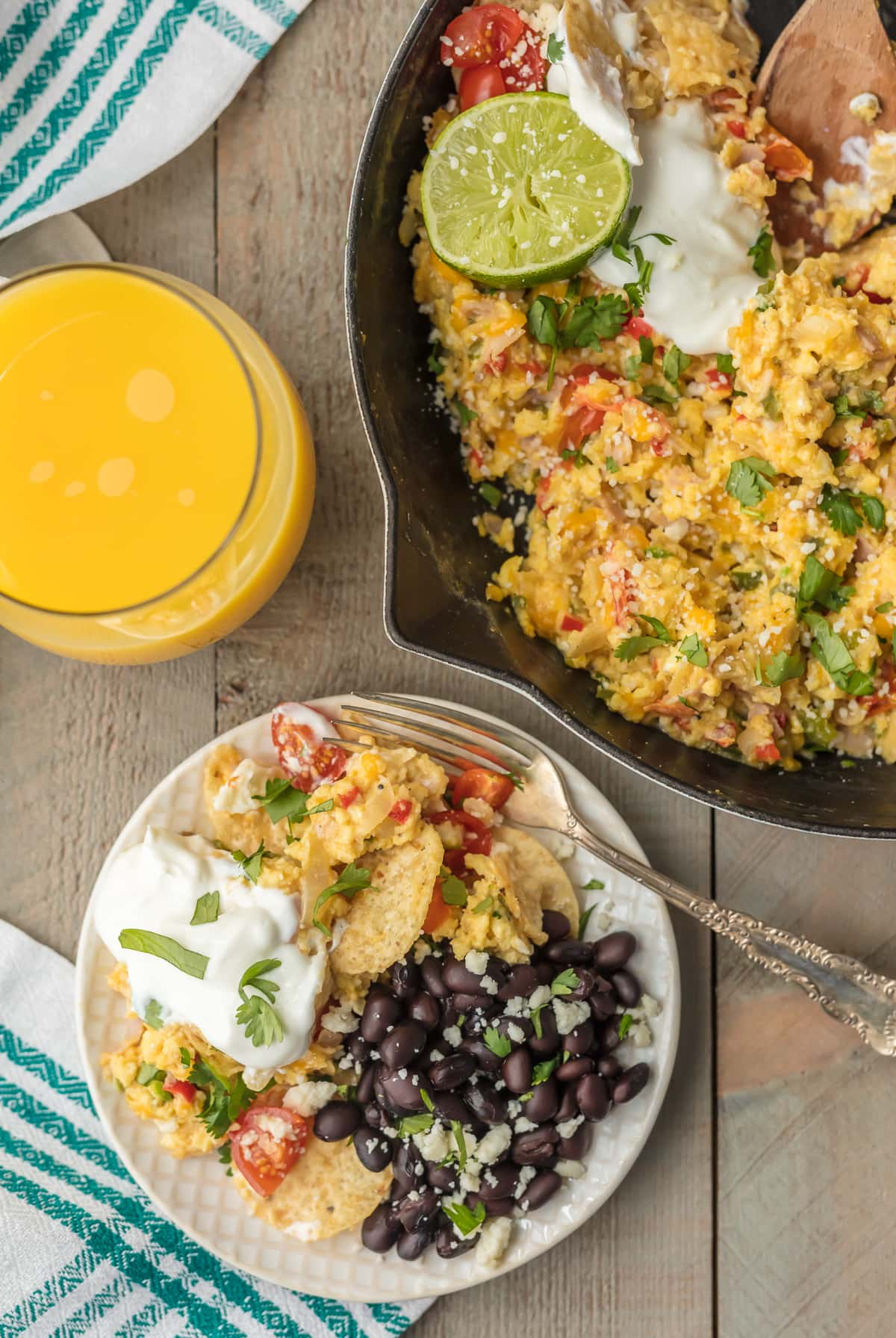 These CHEESY MIGAS are a family favorite breakfast recipe for Christmas morning! Scrambled eggs with lots of cheese, veggies, tortilla chips, and more. It's an easy skillet breakfast the entire family will love!