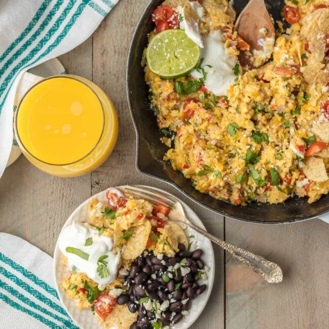 CHEESY MIGAS are a family favorite breakfast recipe for Christmas morning! This Tex-Mex migas recipe is made up of scrambled eggs, lots of cheese, veggies, tortilla chips, and so much more. It's an easy skillet breakfast the entire family will love!