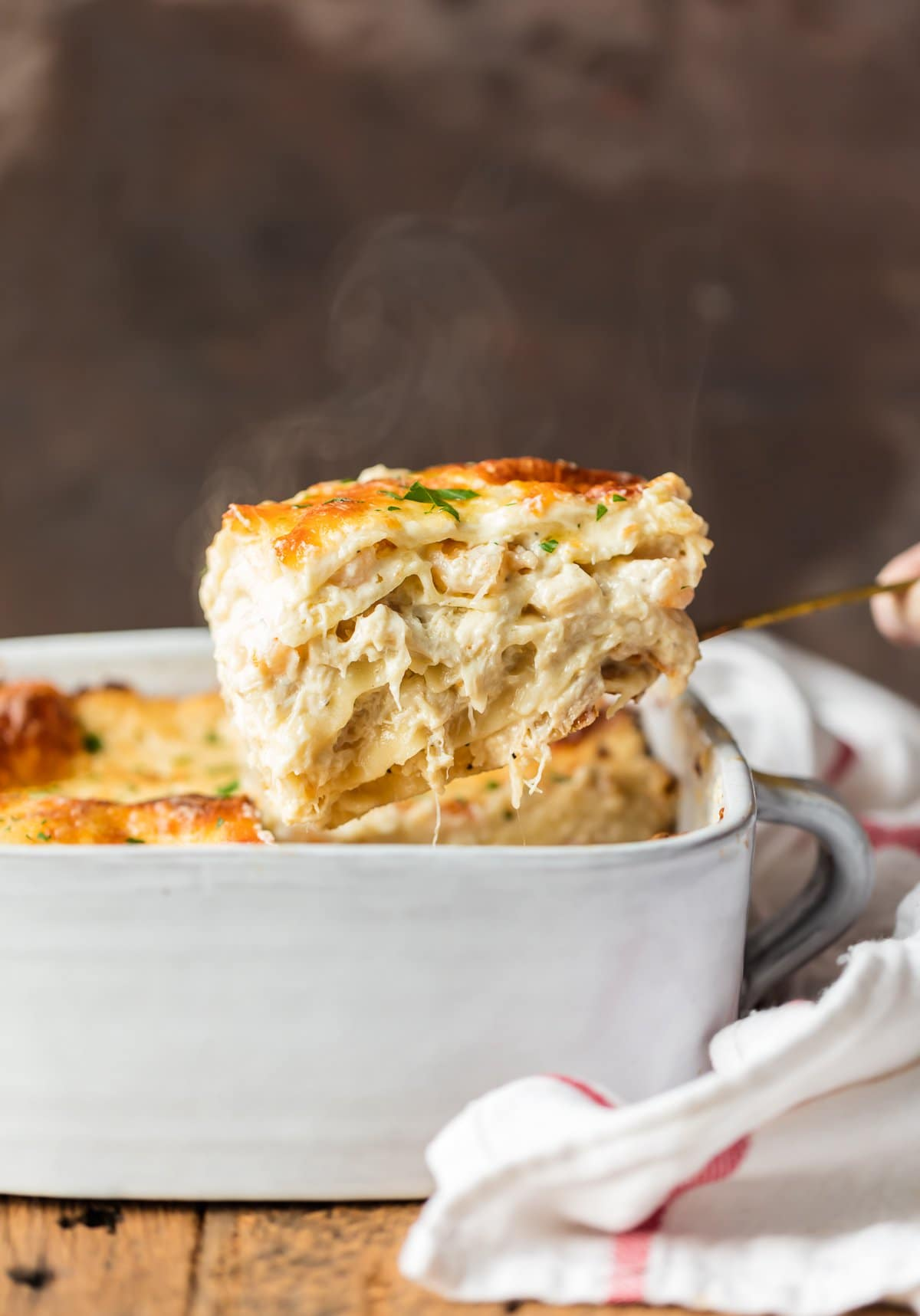 Cheesy Seafood Lasagna in a white baking pan