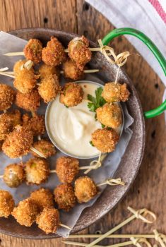 These FRIED BLUE CHEESE STUFFED OLIVES are just delicious. And when served with a simple garlic aioli sauce, they are absolutely addicting! These fried and stuffed olives are the perfect holiday appetizer, just what you need for Christmas or New Year's Eve!