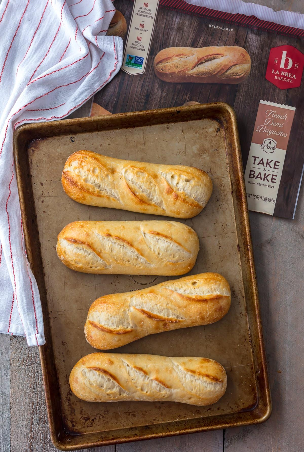 French bread baguettes on a baking tray