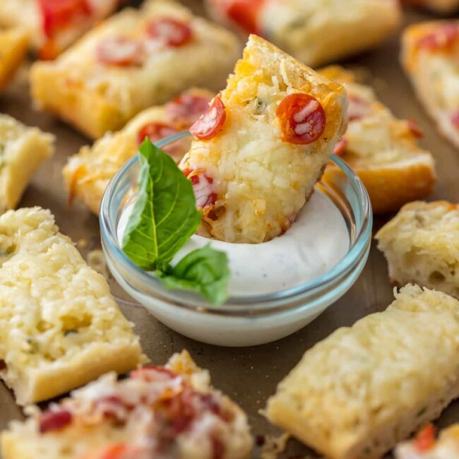 garlic butter french bread pizza bite in dip