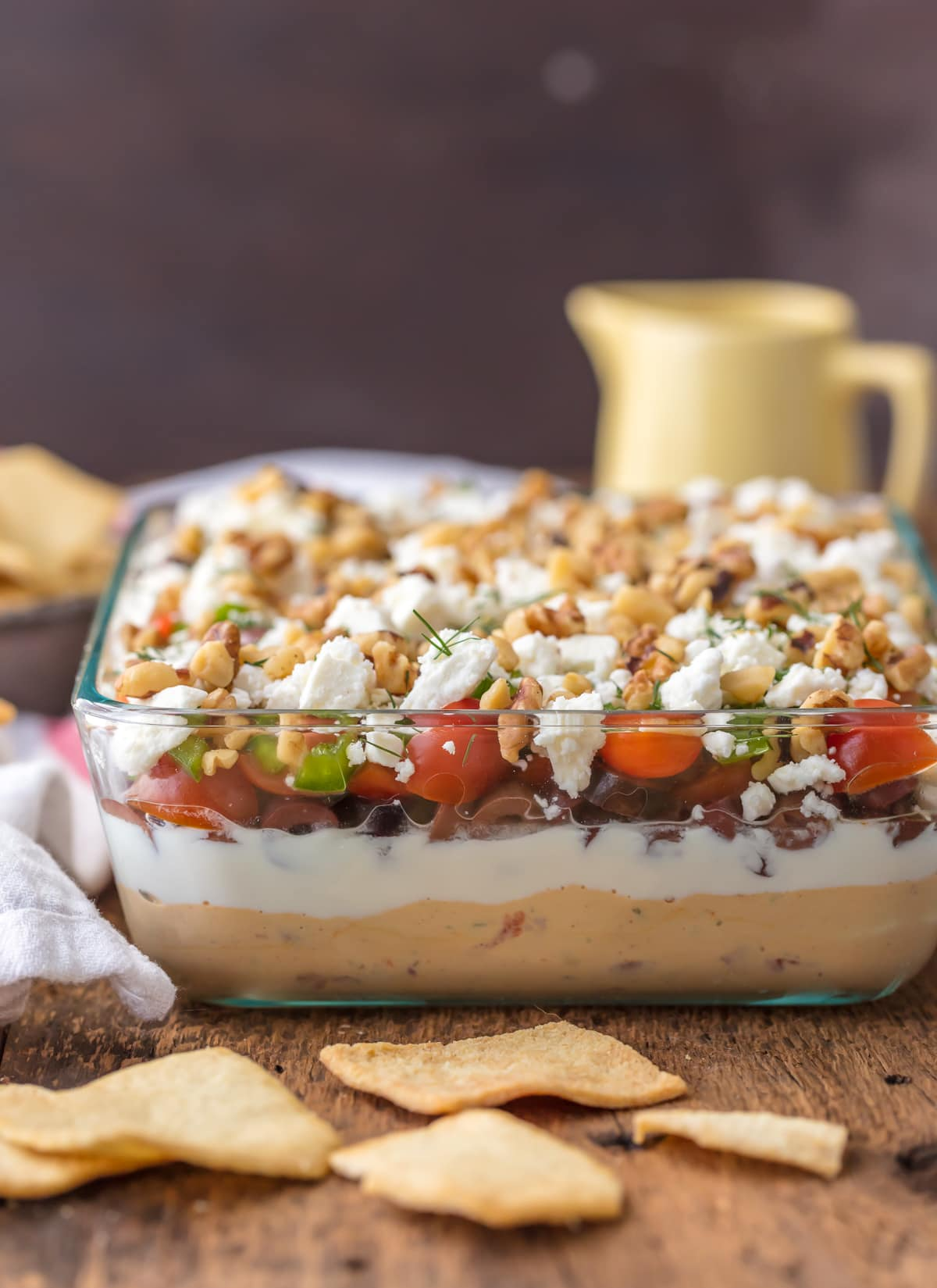 7 layer dip: hummus, yogurt, olives, tomatoes, peppers, feta, walnuts