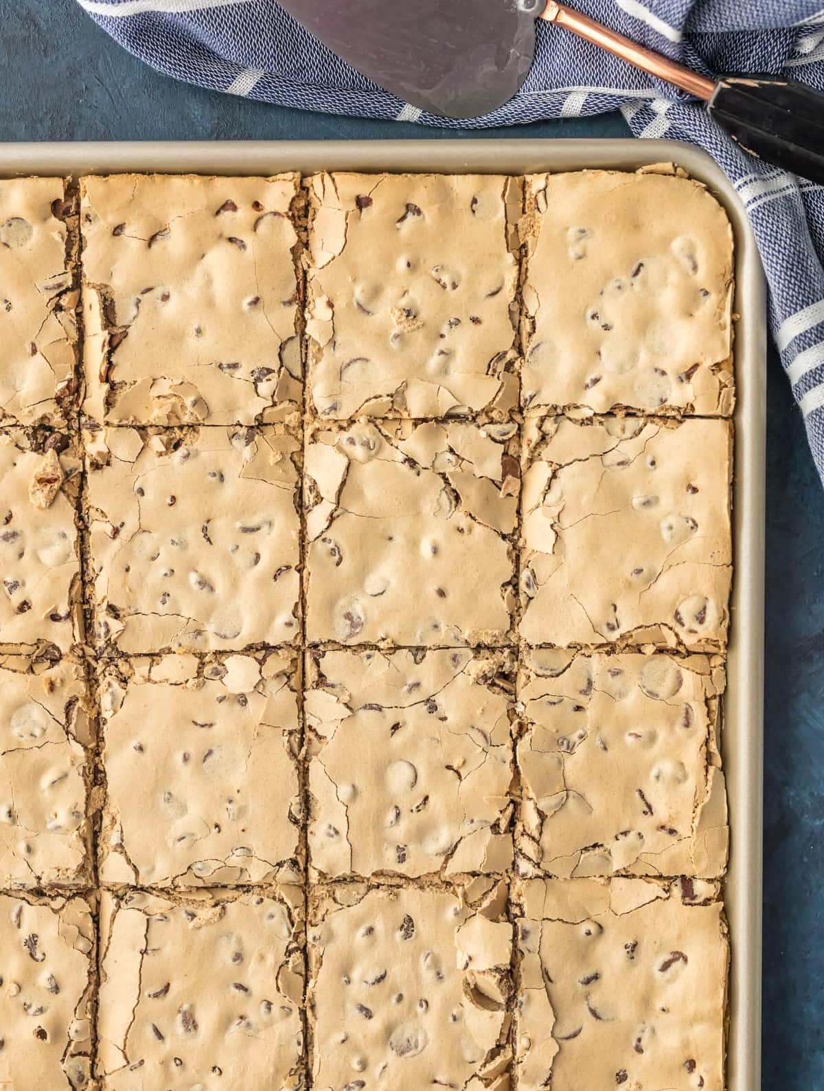 A baking pan filled with chocolate chip bars, but into large squares