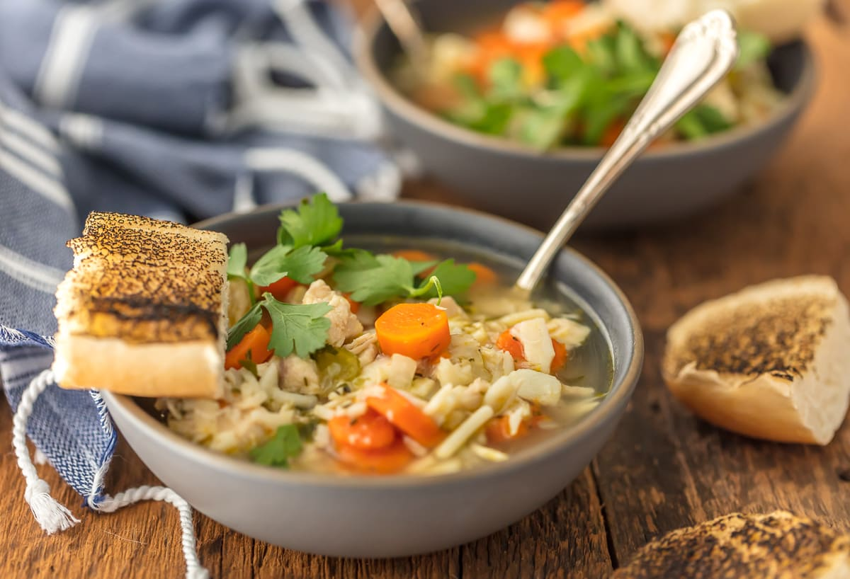 Best Chicken Noodle Soup recipe in a bowl with crusty bread