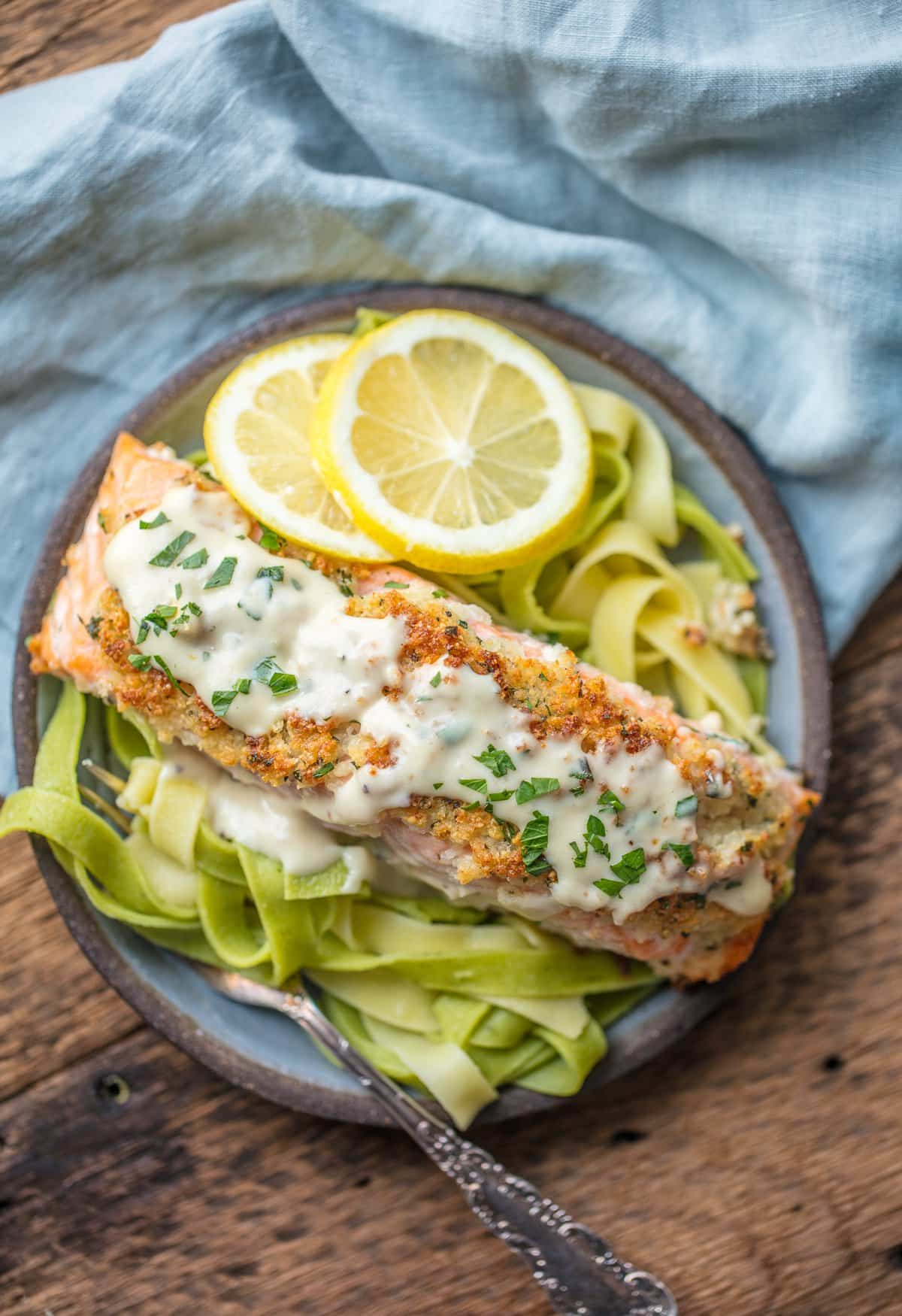 A plate of Parmesan Crusted salmon on a bed of pasta