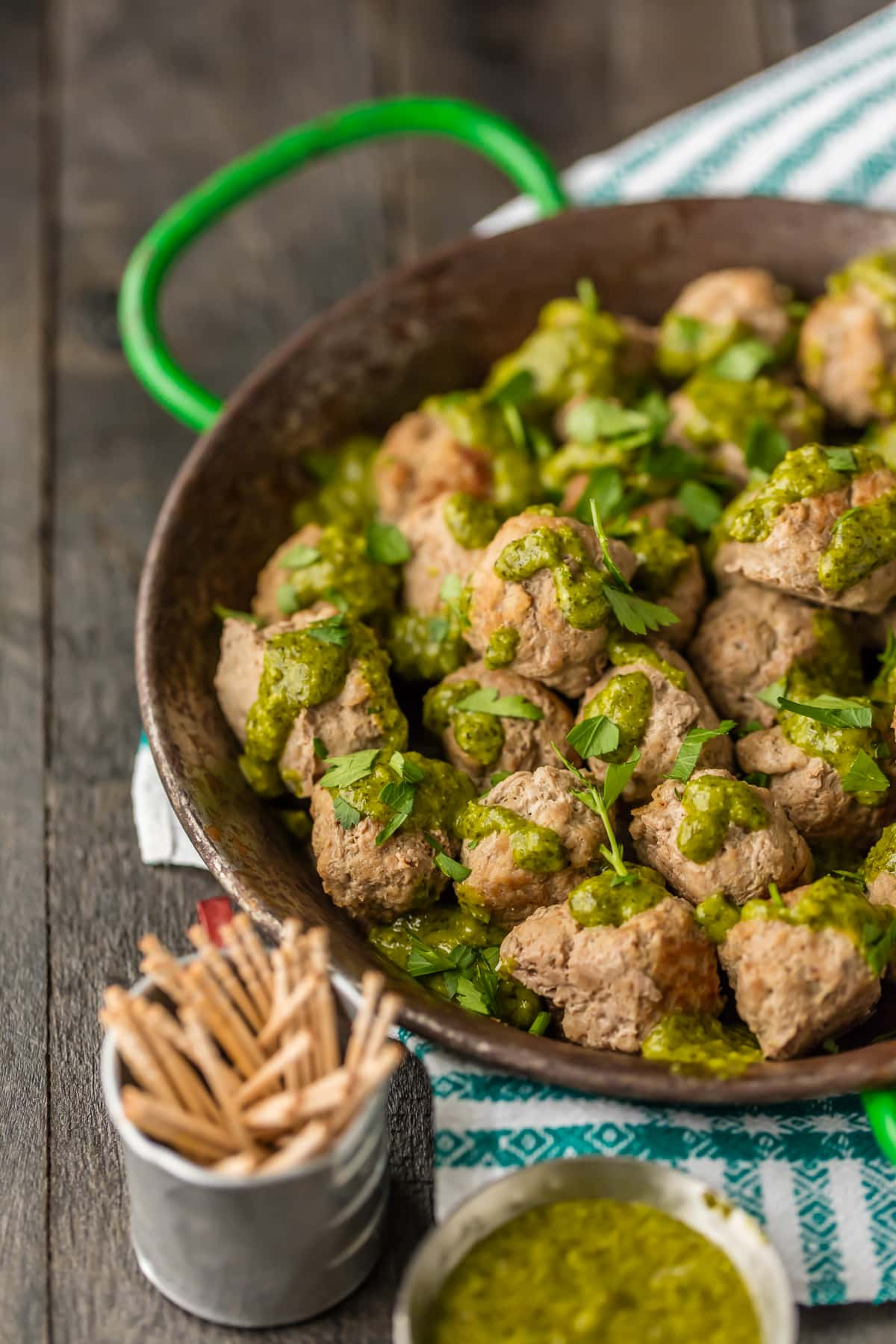 Easy Drop Meatballs on a serving platter, with green sauce