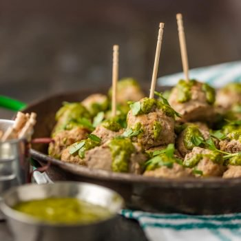 These PERUVIAN CHICKEN MEATBALLS WITH GREEN SAUCE are the perfect holiday or Super Bowl appetizer! The Peruvian green sauce, made with a parsley base, is just the right amount of spicy. The drop meatballs are just the right amount of easy.